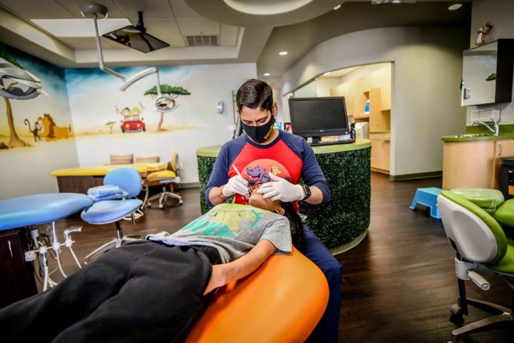 Dr. Shanadi examining a patient - Smile Safari